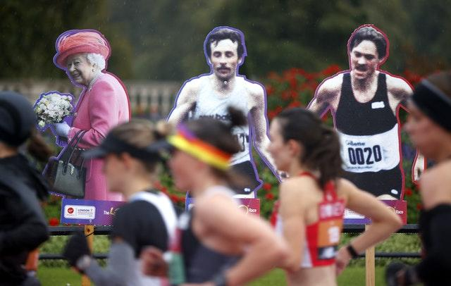 Cardboard cut-outs stood in for the usual crowds lining the marathon route - among them former competitors and the Queen