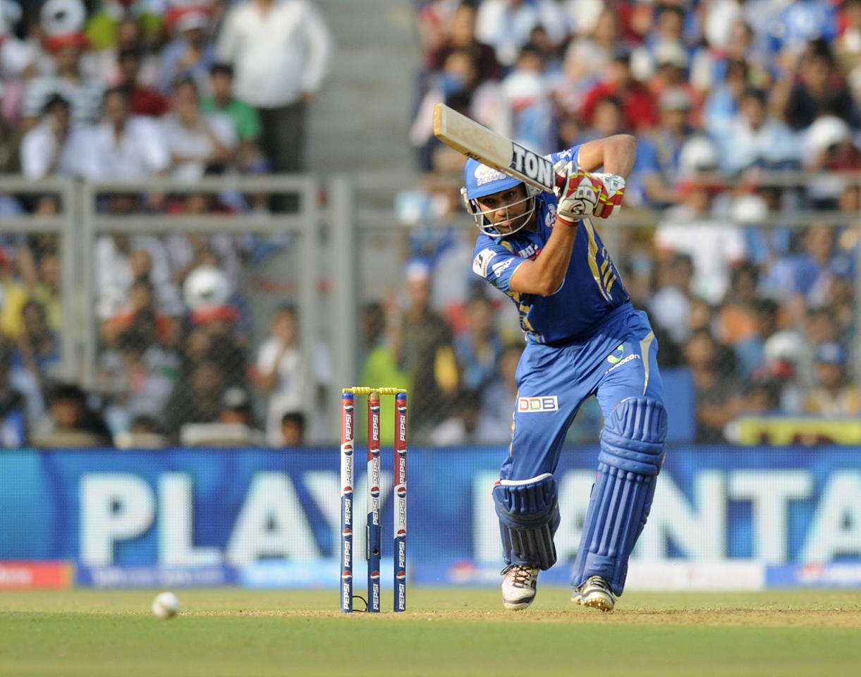 Rohit Sharma of Mumbai Indians bats during match 15 of the Pepsi Indian Premier League ( IPL) 2013  between The Mumbai Indians and the Pune Warriors India  held at the Wankhede Stadium in Mumbai on the 13th April 2013 ..Photo by Pal Pillai-IPL-SPORTZPICS  ..Use of this image is subject to the terms and conditions as outlined by the BCCI. These terms can be found by following this link:..https://ec.yimg.com/ec?url=http%3a%2f%2fwww.sportzpics.co.za%2fimage%2fI0000SoRagM2cIEc&t=1506172641&sig=yygFNy_7x4nTSS4RtS9ofQ--~D