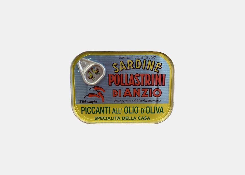 """For a piece of Roman history, look no further than Pollastrini Di Anzio sardines, which come packed in olive oil and hot pepper. The brand's founder began packing sardines in 1889 just outside of Rome, and, today, the wild-caught swimmers are among the tastiest you'll find. Ayesha Nurdjaja, chef and partner of New York's <a href=""""https://www.shukanewyork.com/"""" rel=""""nofollow noopener"""" target=""""_blank"""" data-ylk=""""slk:Shuka"""" class=""""link rapid-noclick-resp"""">Shuka</a> and the soon-to-open <a href=""""https://www.shukettenyc.com/"""" rel=""""nofollow noopener"""" target=""""_blank"""" data-ylk=""""slk:Shukette"""" class=""""link rapid-noclick-resp"""">Shukette</a>, says they're her favorite, often eaten as part of a no-frills lunch of salad, hard-boiled eggs, and sardines on crackers, or in a last-minute <em>pasta con sarde,</em> like her mom used to make: """"Just add fennel and onions,"""" she says. $8, Pastaio Via Corta. <a href=""""https://www.pastaioviacorta.com/shop/pollastrini-di-anzio-sardine-piccanti-all-olio-doliva"""" rel=""""nofollow noopener"""" target=""""_blank"""" data-ylk=""""slk:Get it now!"""" class=""""link rapid-noclick-resp"""">Get it now!</a>"""