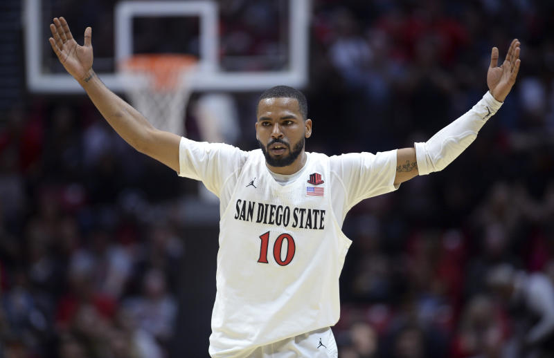 San Diego State guard KJ Feagin gestures during the first half of an NCAA college basketball game against Fresno State Wednesday, Jan. 1, 2020, in San Diego. (AP Photo/Orlando Ramirez)