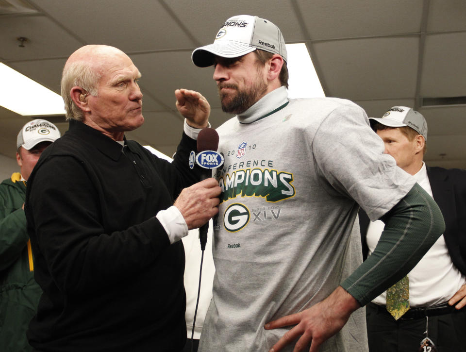 Green Bay Packers' Aaron Rodgers with Terry Bradshaw after the NFC Championship NFL football game against the Chicago Bears Sunday, Jan. 23, 2011, in Chicago. The Packers won 21-14. (AP Photo/David J. Philip)