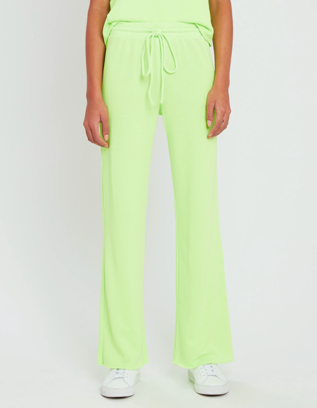 """If you're tired of conversing with your home appliances, spice of your life with a jolt of color via these neon green raw-hem sweatpants. $128, Verishop. <a href=""""https://www.verishop.com/lanston-sport/pants/porter-straight-leg-pant/p1835557158947?color=neon"""" rel=""""nofollow noopener"""" target=""""_blank"""" data-ylk=""""slk:Get it now!"""" class=""""link rapid-noclick-resp"""">Get it now!</a>"""