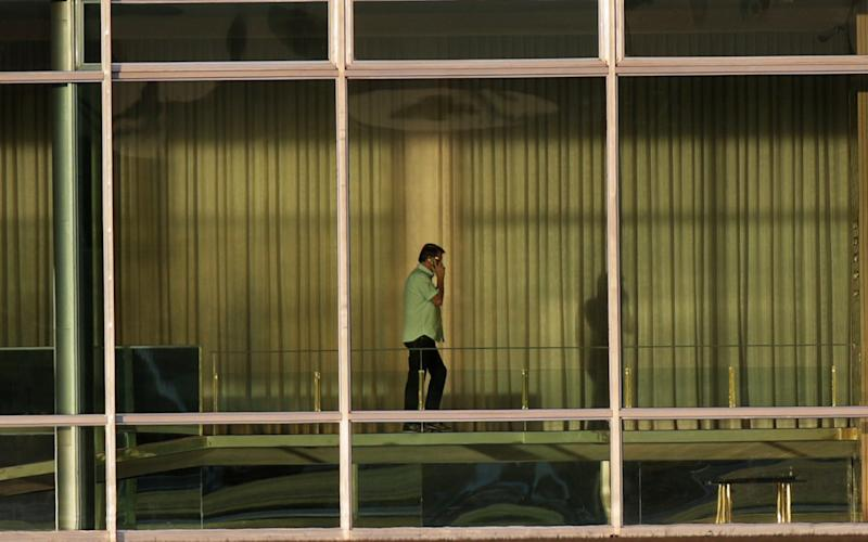 Brazil's President Jair Bolsonaro was seen at the Alvorada Palace in Brasilia yesterday (July 8), amid the outbreak of the novel coronavirus - for which Mr Bolsonaro this week announced he has tested positive. - Ueslei Marcelino/Reuters