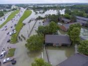 In this photo taken by a drone is an aerial view of the flooded Siegen Calais apartments Tuesday, May 18, 2021, in Baton Rouge, La. Heavy rains have swept across southern Louisiana, flooding homes, swamping cars and closing a major interstate. (John Ballance/The Advocate via AP)