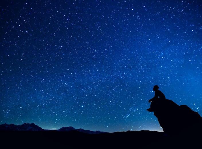 """<span class=""""caption"""">It can stretch your mind to ponder what's really out there.</span> <span class=""""attribution""""><a class=""""link rapid-noclick-resp"""" href=""""https://www.gettyimages.com/detail/photo/silhouette-man-sitting-on-rock-against-royalty-free-image/615314285"""" rel=""""nofollow noopener"""" target=""""_blank"""" data-ylk=""""slk:Stijn Dijkstra/EyeEm via Getty Images"""">Stijn Dijkstra/EyeEm via Getty Images</a></span>"""