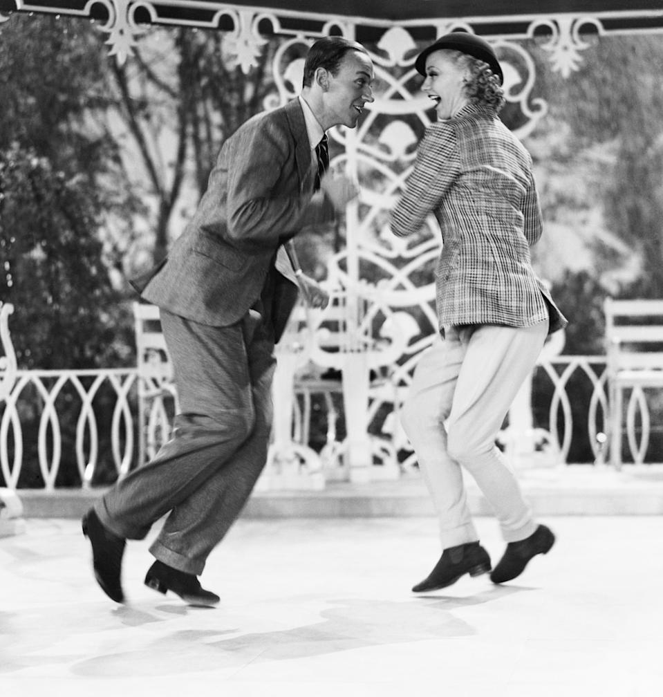 "(Original Caption) 05/25/1935 -Hollywood, CA- Fred Astaire and Ginger Rogers, famous dancing team of the screen, shown in a dizzy whirl of a dance from their latest picture, ""Top Hat"". BPA 2 #3545"