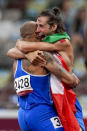 Lamont Jacobs, left, of Italy, celebrates after winning the men's the 100-meter final with high jump winner Gianmarco Tamberi, also of Italy, at the 2020 Summer Olympics, Sunday, Aug. 1, 2021, in Tokyo. (AP Photo/Petr David Josek)
