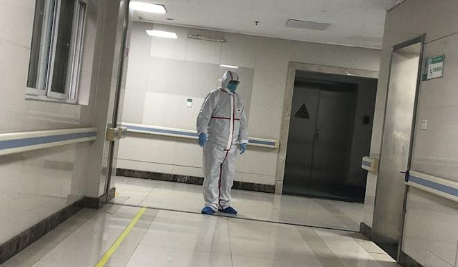 A doctor wears protective gear at a hospital in Wuhan where patients hit by the virus are being treated. Photo: Simon Song