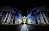 Military vehicles patrol on Piazza del Popolo in central Rome on December 31, 2020