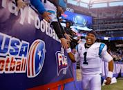 Cam Newton of the Carolina Panthers celebrates with fans on December 20, 2015, after leading his team to victory over the New York Giants 38 to 35 (AFP Photo/Michael Reaves)