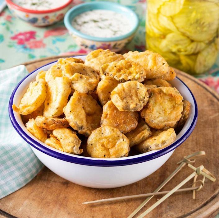 """<p>Pickles are great when layered on burgers, but they're even better when they're battered and fried. Serve them instead of a bag of chips with a side of ranch for dipping.</p><p><a href=""""https://www.thepioneerwoman.com/food-cooking/recipes/a35880840/fried-pickles-recipe/"""" rel=""""nofollow noopener"""" target=""""_blank"""" data-ylk=""""slk:Get the recipe."""" class=""""link rapid-noclick-resp""""><strong>Get the recipe. </strong></a></p><p><a class=""""link rapid-noclick-resp"""" href=""""https://go.redirectingat.com?id=74968X1596630&url=https%3A%2F%2Fwww.walmart.com%2Fsearch%2F%3Fquery%3Ddeep%2Bfry%2Bthermometers&sref=https%3A%2F%2Fwww.thepioneerwoman.com%2Ffood-cooking%2Fmeals-menus%2Fg36353420%2Ffourth-of-july-side-dishes%2F"""" rel=""""nofollow noopener"""" target=""""_blank"""" data-ylk=""""slk:SHOP DEEP FRY THERMOMETERS"""">SHOP DEEP FRY THERMOMETERS</a></p>"""