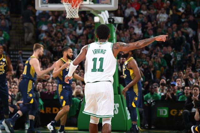 Boston Celtics star Kyrie Irving directs traffic during Game 2 against the Indiana Pacers. (Getty Images)