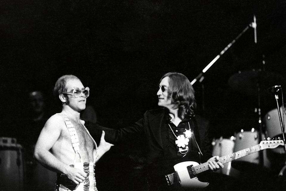"<p>In 1974, Elton John  fans flocked to see him play Madison Square Garden. During the special Thanksgiving show, John Lennon came on stage for the first time in two years — and for what would also prove to be his <a href=""https://liveforlivemusic.com/features/forty-years-later-remembering-john-lennons-last-major-performance-with-elton-john-in-1974/"" rel=""nofollow noopener"" target=""_blank"" data-ylk=""slk:final major performance"" class=""link rapid-noclick-resp"">final major performance</a> before his death in 1980. </p>"