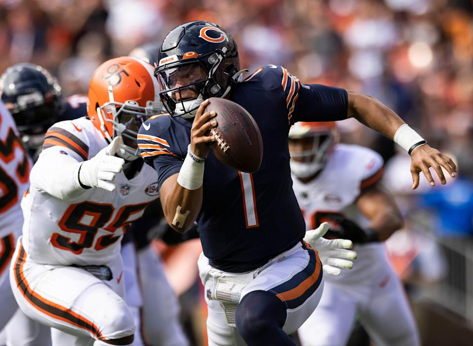 Browns defensive end Myles Garrett reaches for Bears QB Justin Fields in the third quarter. Fields was sacked nine times Sunday.