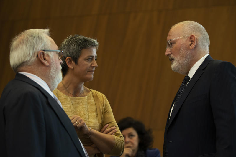 European Competition Commissioner Margrethe Vestager, second left, talks to European Commission Vice-President Frans Timmermans, right, and European Commissioner for Energy Miguel Arias Canete before a meeting at the European Commission headquarters in Brussels, Wednesday, Sept. 19, 2018. The European Union has ruled that Luxembourg did not give the U.S. fast food giant McDonald's a special sweet tax deal and that the non-taxation of some of its profits did not amount to illegal state aid. (AP Photo/Francisco Seco)