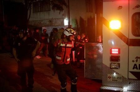 Members of the Red Cross arrive outside a building after a structural collapse in a car park under construction in Mexico City