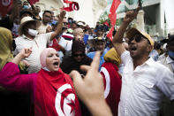 Tunisian demonstrators chant slogans during a protest against Tunisian President Kais Saied, Saturday, Sept. 18, 2021 in Tunis. In July Tunisian President Kais Saied fired the country's prime minister and froze parliament's activities after violent demonstrations over the country's pandemic and economic situation. The movement made by Saied was considered by his opponents as a coup. (AP Photo/Riadh Dridi)