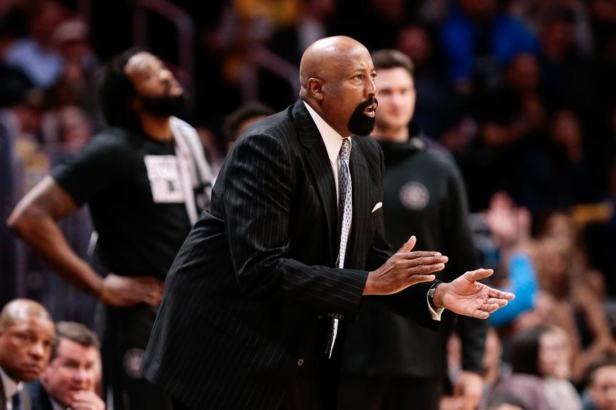 Mike Woodson claps hands while coaching Clippers game