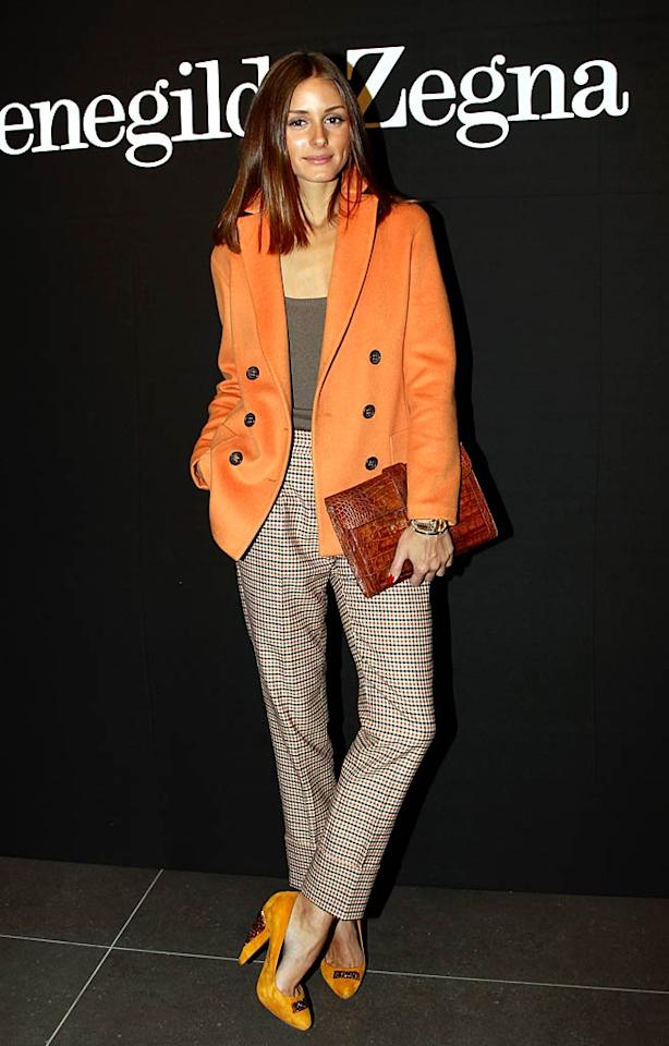 "Olivia Palermo took a fashion risk (that totally paid off!) by wearing an autumnal ensemble in winter. Upon arriving at the Ermenegildo Zegna fashion show in Milan, the former ""City"" star strutted her stuff in Agnona separates and accessorized with mustard-colored Kurt Geiger pumps and her signature Hermes clutch. Vittorio Zunino Celotto/<a href=""http://www.gettyimages.com/"" target=""new"">GettyImages.com</a> - January 15, 2011"