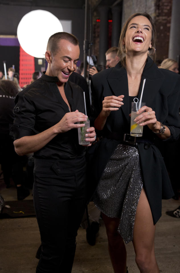 <p>Julien and Alessandra relax backstage sipping on vodka.<em> [Photo: PA]</em> </p>