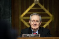 Chairman Mike Crapo, R-Idaho, listens as Federal Reserve Chair Jerome Powell and Treasury Secretary Steven Mnuchin, not pictured, testify during a Senate Banking Committee hearing on Capitol Hill, on Tuesday, Dec. 1, 2020, in Washington. (Al Drago/The New York Times via AP, Pool)