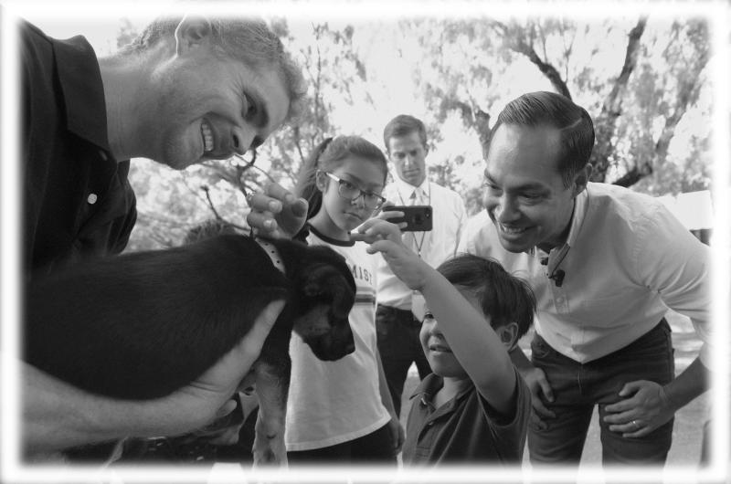 Julian Castro, right, with his son Cristian, and daughter Carina, visit with Ivan, a puppy up for adoption, during a stop at the Animal Defense League of Texas shelter, Monday, Aug. 19, 2019, in San Antonio. (Photo: Eric Gay/AP; digitally enhanced by Yahoo News)