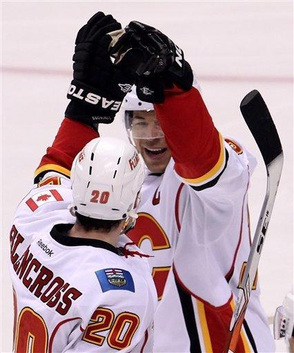 Calgary Flames left wing Curtis Glencross (20) celebrates his goal with Flames right wing Jarome Iginla (12) during third period NHL hockey action against the Vancouver Canucks at Rogers Arena in Vancouver, British Columbia Friday, Dec, 23, 2011.(AP Photo/The Canadian Press, Jonathan Hayward)
