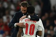 England coach Gareth Southgate embraces forward Raheem Sterling after the Euro 2020 final