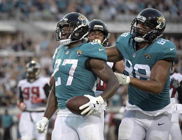 FILE -In this Aug. 25, 2018, file photo, Jacksonville Jaguars running back Leonard Fournette (27) celebrates his 21-yard rushing touchdown with tight end Austin Seferian-Jenkins (88) during the first half of an NFL preseason football game against the Atlanta Falcons in Jacksonville, Fla. Leonard Fournette is good to go for Sunday's game at Indianapolis. The fourth overall pick in the 2017 NFL draft missed the last four games and six of eight this season because of a strained right hamstring. (AP Photo/Phelan M. Ebenhack, File)