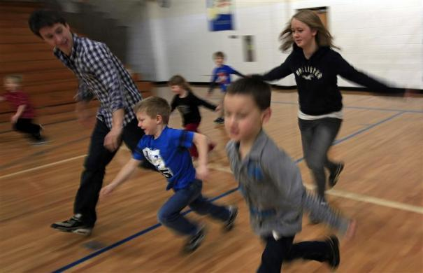 Pedro Moreno Martinez (L), a foreign exchange student from Madrid, Spain and Greta Terlaak (R) from Ottersweier, Germany play with children as part of their mentoring program at Grant-Deuel School in Revillo, South Dakota February 14, 2012.
