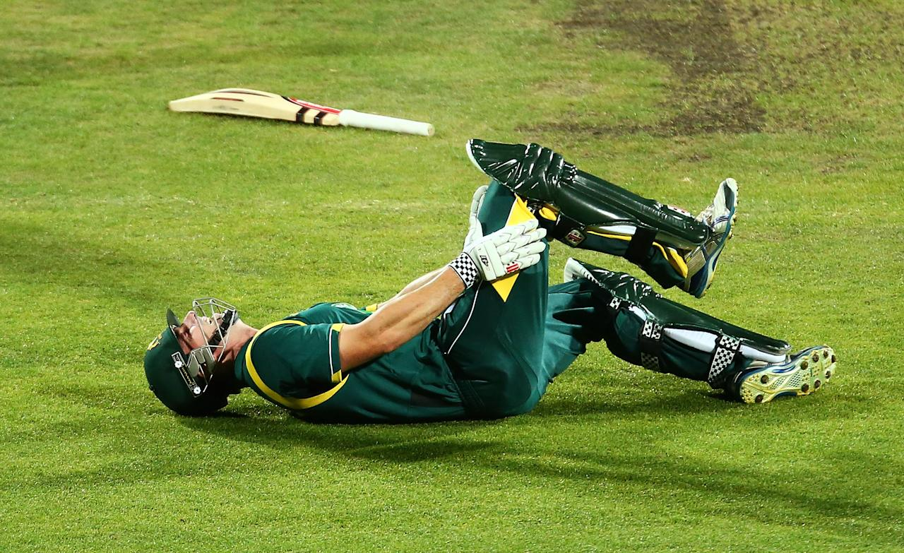 HOBART, AUSTRALIA - FEBRUARY 16:  Shaun Marsh of Australia A falls to the ground and clutches his right knee while taking a single during the international tour match between Australia 'A' and the England Lions at Blundstone Arena on February 16, 2013 in Hobart, Australia.  (Photo by Mark Nolan/Getty Images)