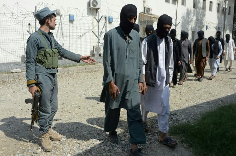Afghan security forces escorting alleged Islamic State group fighters and Taliban in Jalalabad, amid reports that French and Algerian fighters, some arriving from Syria, have joined the jihadist group in northern Afghanistan