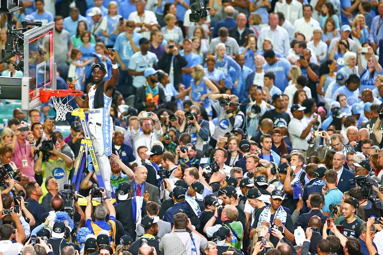 <p>North Carolina Tar Heels forward Theo Pinson (1) cuts the net after the game against the Gonzaga Bulldogs in the championship game of the 2017 NCAA Men's Final Four at University of Phoenix Stadium. North Carolina defeated Gonzaga 71-65. Mandatory Credit: Mark J. Rebilas-USA TODAY Sports </p>