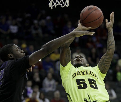 Baylor guard Pierre Jackson (55) puts up a shot under pressure from Kansas State forward Jamar Samuels (32) during the first half of an NCAA college basketball game in the Big 12 Conference tournament, Thursday, March 8, 2012, in Kansas City, Mo. (AP Photo/Charlie Riedel)