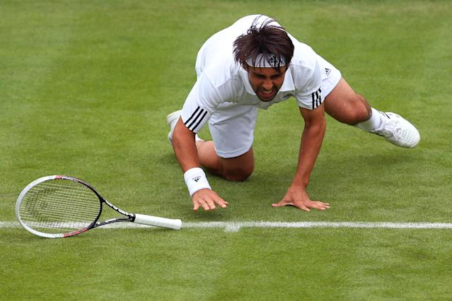 LONDON, ENGLAND - JUNE 24: Fabio Fognini of Italy slips during his Gentleman's singles first round match against Jurgen Melzer of Austria on day one of the Wimbledon Lawn Tennis Championships at the All England Lawn Tennis and Croquet Club on June 24, 2013 in London, England. (Photo by Julian Finney/Getty Images)
