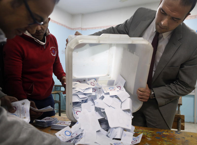 Election workers count ballots at the end of three-day vote of the referendum on constitutional amendments at polling station in Cairo, Egypt, Monday, April 22, 2019. Egyptians are voting on constitutional amendments that would allow el-Sissi to stay in power until 2030.(AP Photo/Amr Nabil)