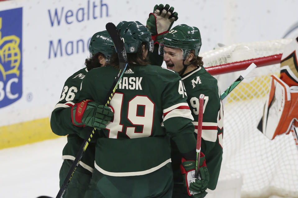 Minnesota Wild's Victor Rask (49) celebrates with teammates Mats Zuccarello (36) and Kirill Kaprizov (97) after scoring a goal against the Anaheim Ducks during the first period of an NHL hockey game Friday, May 7, 2021, in St. Paul, Minn. (AP Photo/Stacy Bengs)