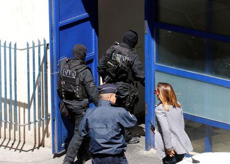 """French police and members of special Police units RAID conduct an investigation after two Frenchmen were arrested in Marseille, France, April 18, 2017 for planning to carry out an """"imminent and violent attack"""" ahead of the first round of the presidential election on Sunday, France's interior minister said. REUTERS/Philippe Laurenson"""