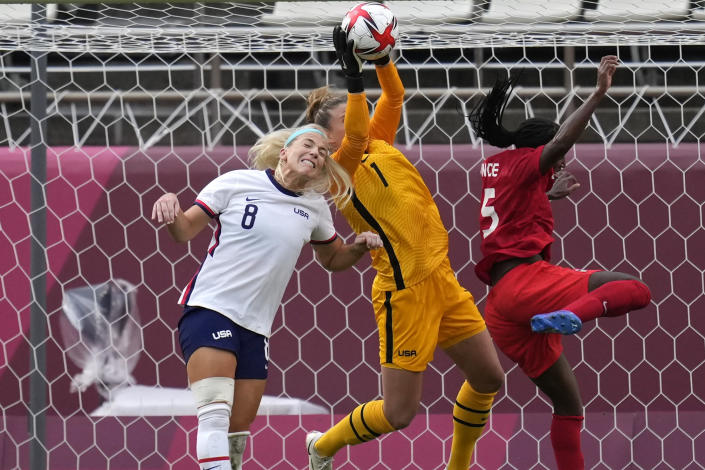United States' goalkeeper Alyssa Naeher, center, catches a ball during a women's semifinal soccer match against Canada at the 2020 Summer Olympics, Monday, Aug. 2, 2021, in Kashima, Japan. (AP Photo/Andre Penner)