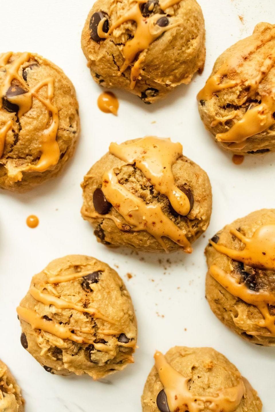 """<p>Give these soft, fluffy cookies a heavy drizzle of peanut butter and they're pretty much perfect. </p><p><a class=""""link rapid-noclick-resp"""" href=""""https://www.onceuponapumpkinrd.com/healthy-peanut-butter-banana-cookies/"""" rel=""""nofollow noopener"""" target=""""_blank"""" data-ylk=""""slk:GET THE RECIPE"""">GET THE RECIPE</a></p><p><em>Per serving: 147 calories, 8 g fat, 16.4 g carbs, 136 mg sodium, 8 g sugar, 1.2 g fiber, 3 g protein</em><br></p>"""