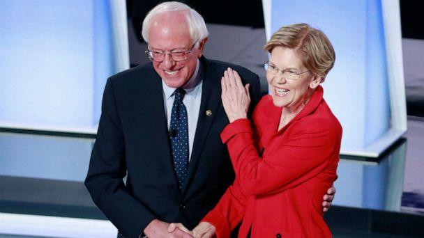 PHOTO: Senator Bernie Sanders and Senator Elizabeth Warren shake hands before the start of the first night of the second 2020 Democratic presidential debate in Detroit, July 30, 2019. (Lucas Jackson/Reuters)