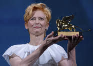 Actress Tilda Swinton holds her Golden Lion For Lifetime Achievement award during the opening ceremony of the 77th edition of the Venice Film Festival at the Venice Lido, Italy, Wednesday, Sep. 2, 2020. The Venice Film Festival will go from Sept. 2 through Sept. 12. Italy was among the countries hardest hit by the coronavirus pandemic, and the festival will serve as a celebration of its re-opening and a sign that the film world, largely on pause since March, is coming back as well. (AP Photo/Domenico Stinellis)