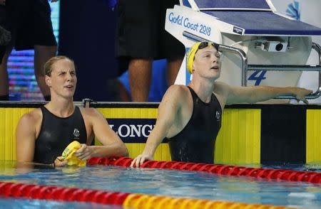 Swimming - Gold Coast 2018 Commonwealth Games - Women's 100m Freestyle Semifinal 2 - Optus Aquatic Centre - Gold Coast, Australia - April 8, 2018. Cate Campbell and Bronte Campbell of Australia reacts. REUTERS/David Gray