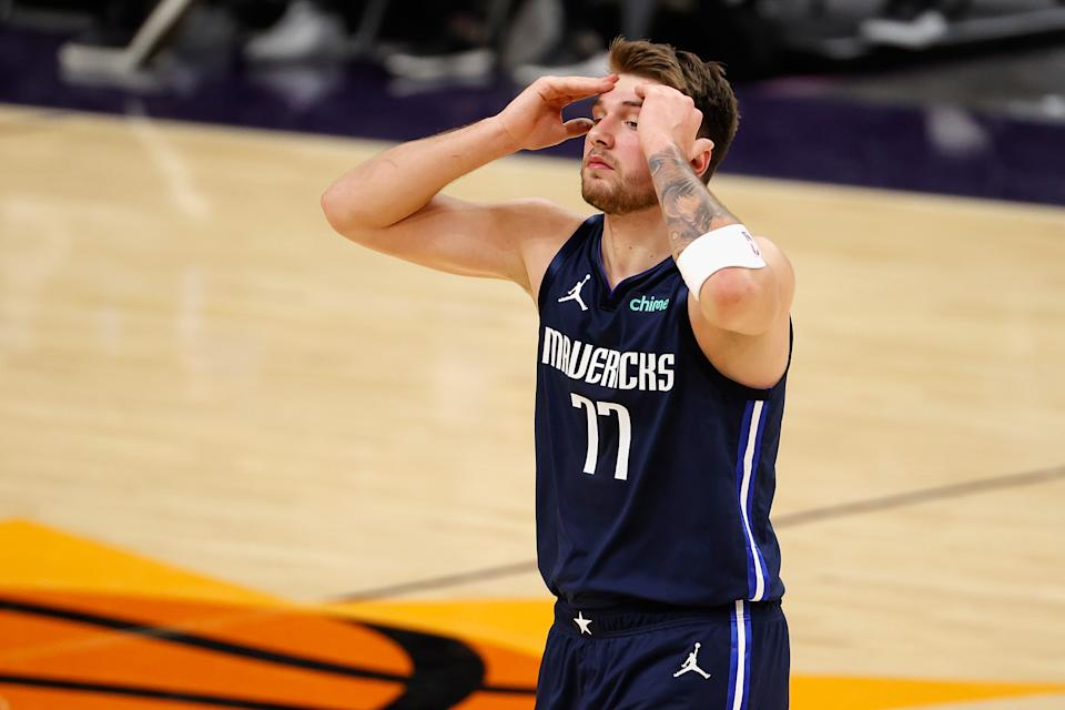 PHOENIX, ARIZONA - DECEMBER 23: Luka Doncic #77 of the Dallas Mavericks reacts to a foul call during the second half of the NBA game against the Phoenix Suns at PHX Arena on December 23, 2020 in Phoenix, Arizona.  NOTE TO USER: User expressly acknowledges and agrees that, by downloading and/or using this Photograph, user is consenting to the terms and conditions of the Getty Images License Agreement. Mandatory Copyright Notice: Copyright 2020 NBAE (Photo by Christian Petersen/Getty Images)
