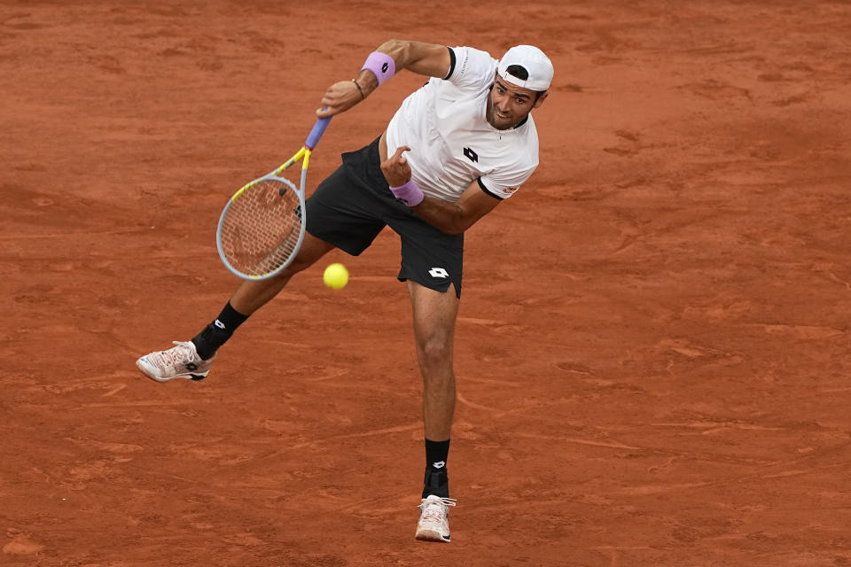 Italy's Matteo Berrettini serves the ball as he plays Serbia's Novak Djokovic during their quarterfinal match of the French Open tennis tournament at the Roland Garros stadium Wednesday, June 9, 2021 in Paris. (AP Photo/Michel Euler)