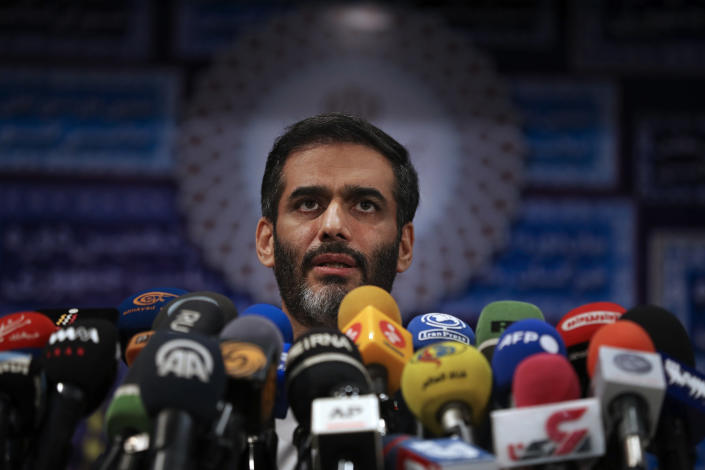 Revolutionary Guard Gen. Saeed Mohammad, who once headed the the paramilitary force's Khatam al-Anbiya Construction Headquarters, speaks with media after registering his name as a candidate for the June 18 presidential elections at the elections headquarters of the Interior Ministry in Tehran, Iran, Tuesday, May 11, 2021. Iran opened registration Tuesday for potential candidates in the country's June presidential election, kicking off the race as uncertainty looms over Tehran's tattered nuclear deal with world powers and tensions remain high with the West. (AP Photo/Vahid Salemi)