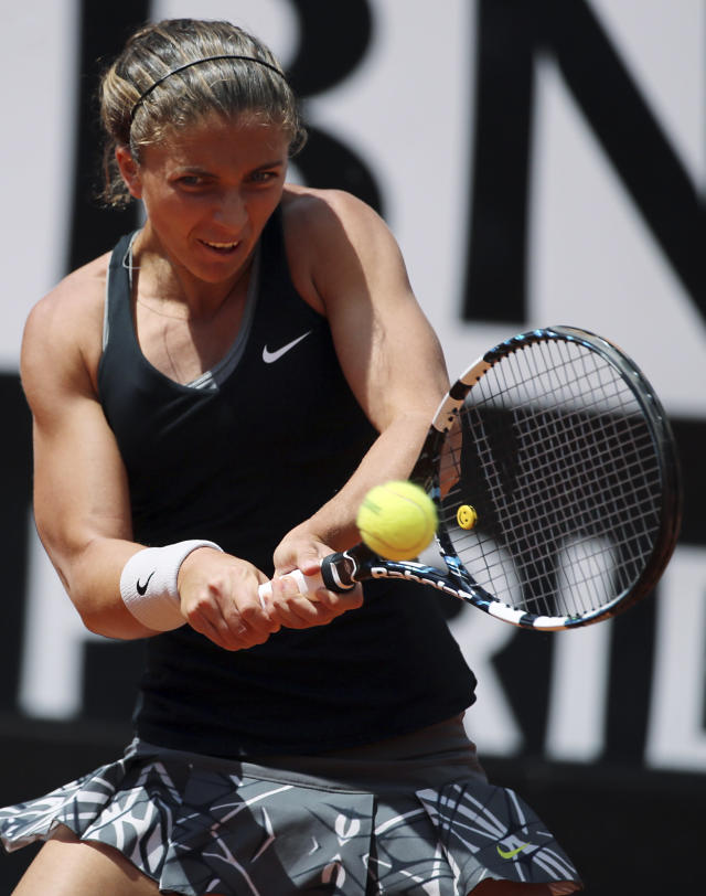 Italy's Sara Errani, returns the ball during the final match against Serena Williams, at the Italian open tennis tournament in Rome, Sunday, May 18, 2014. Serena Williams kept the crowd from being a factor in a 6-3, 6-0 victory over 10th-seeded Sara Errani to win the Italian Open for the third time Sunday. (AP Photo/Gregorio Borgia)