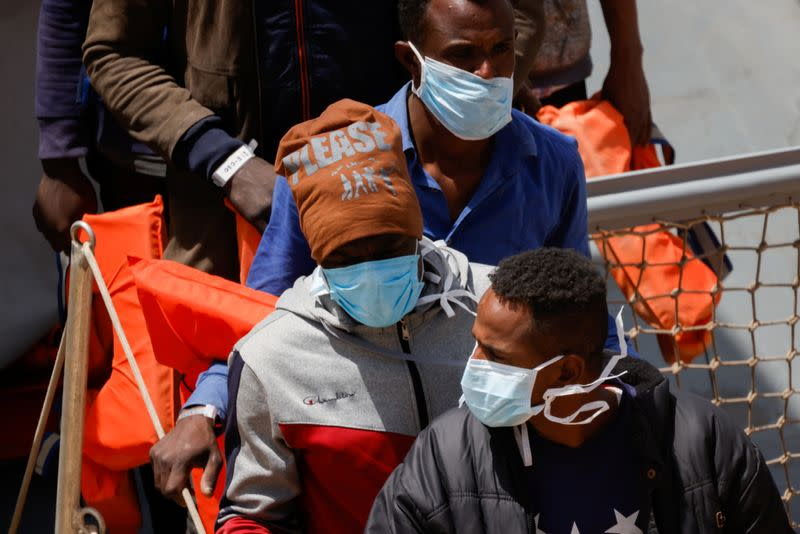 Rescued migrants disembark from an Armed Forces of Malta vessel in Senglea, in Valletta's Grand Harbour