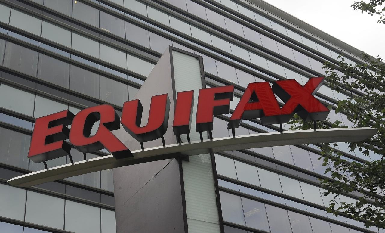 This Saturday, July 21, 2012, photo shows signage at the corporate headquarters of Equifax Inc. in Atlanta. New York Attorney General Eric Schneiderman is pressing credit monitoring companies TransUnion and Experian to explain what cybersecurity they have in place to protect sensitive consumer information following a breach at Equifax, discovered by the company in July 2017, that exposed the data of 143 million Americans. (AP Photo/Mike Stewart)