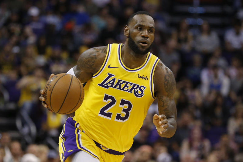 FILE - In this Saturday, March 2, 2019, file photo, Los Angeles Lakers forward LeBron James (23) controls the ball in the second half during an NBA basketball game against the Phoenix Suns in Phoenix. That LeBron James jersey could get a little more expensive. Companies that make clothing and shoes for the National Basketball Association players are in the crosshairs of President Donald Trump's escalating China trade wars. (AP Photo/Rick Scuteri, File)